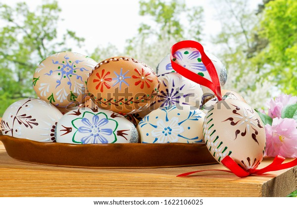 Painted Easter eggs in the garden