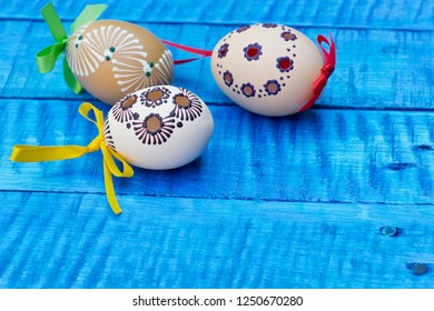 Painted Easter eggs on the blue table