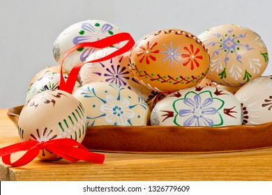Painted Easter eggs on the ceramic bowl.