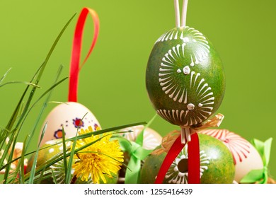 Painted easter eggs on the green background