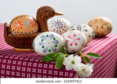 Painted Easter eggs on the red tablecloth