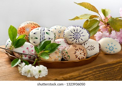 Painted Easter eggs on the wooden desk