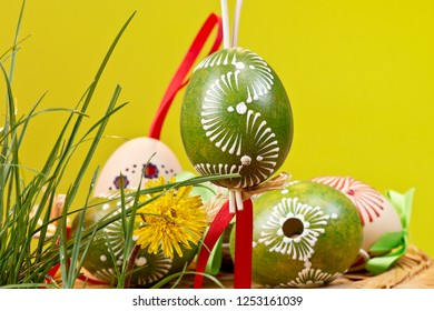 Painted Easter eggs on the yellow background