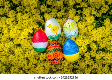 Painted Easter eggs on yellow flowers