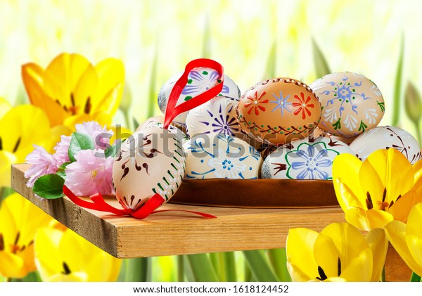Painted Easter eggs with tulips in the garden