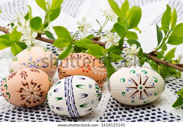 Painted Easter eggs with a twig on the desk