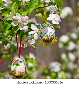 Painted Easter egss hanging on the apple tree in the springtime