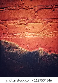 Painted exposed brick wall
