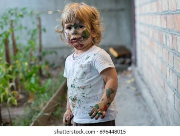 Painted face of child. Little funny dirty boy