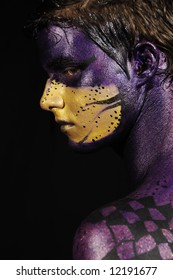 Painted fantasy face - young male model wearing artistic bodypaint drawing