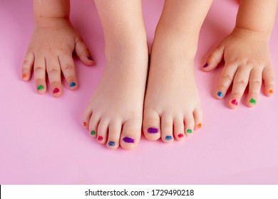 Painted girl's nails on pink paper, flat lay and place for text