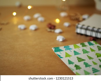 Painted green Christmas trees on a white sheet of paper with paints