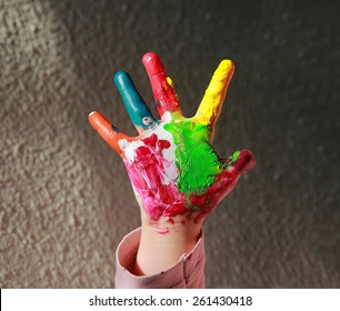 Painted hand isolated on grey background.