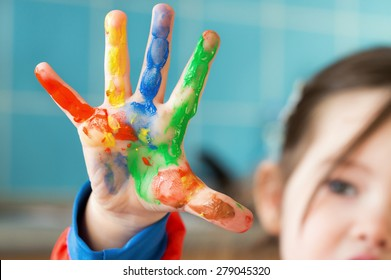 A painted hand of a little girl