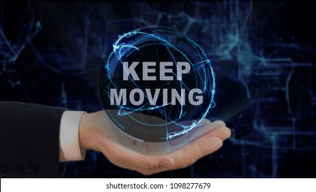 Painted hand shows concept hologram Keep moving on his hand. Drawn man in business suit with future technology screen and modern cosmic background