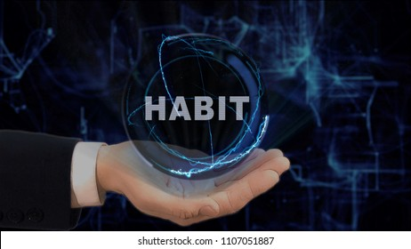 Painted hand shows concept hologram Habit on his hand. Drawn man in business suit with future technology screen and modern cosmic background