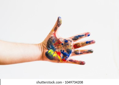 A painted hand of a young man against white background