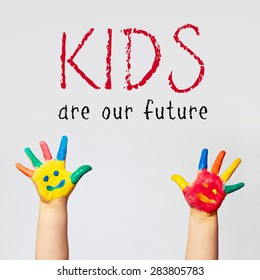 painted hands of little child - kids are our future