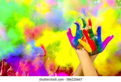 painted hands on colorful background