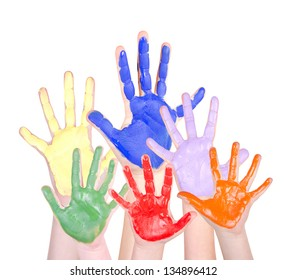 Painted hands in rainbow colors raised, isolated on a white background