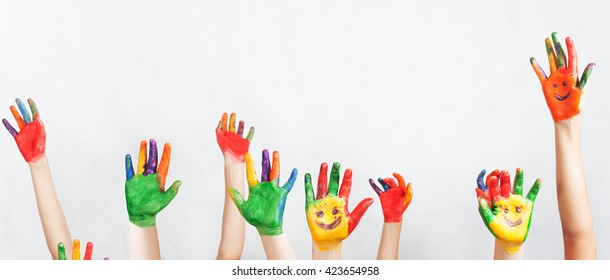 Lot of painted hands raised up.