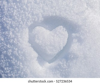 a painted heart in snow in winter