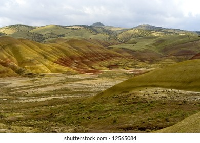 Painted hills are the geological evidence of climate changes between temperate and tropical climates. Here's a lovely shot of part of the Painted Hills with a stormy sky lingering above.