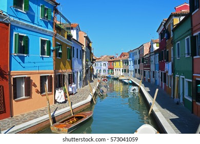 Painted houses and canal, colorful village, Burano, Venice, Italy