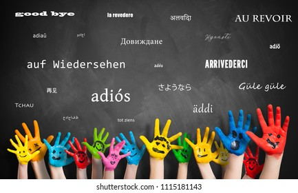 "painted kids hands in front of a blackboard with the message ""goodbye"" in many languages"
