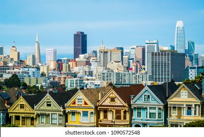 Painted Ladies architecture row homes and houses in San Francisco, California, USA Bay Area City on a slope May 2018 skyline cityscape with Full House row and iconic city view