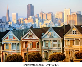 The Painted Ladies of San Francisco at sunset with downtown background