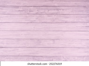 Painted Light Pink and Gray Rustic Wood Board Background that can be either horizontal or vertical. Blank Room or Space area for copy, text,  your words, above looking down view. Tinted photo.