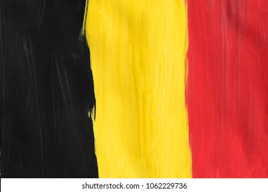 Painted national Belgian tricolor as a background