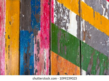 Painted old wooden background with peeling paint.