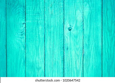 Painted pastel turquoise wood surface, with an abstract expressive vertical line texture. Pastel background for design