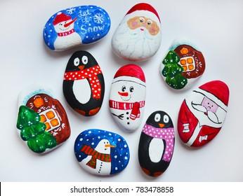 Painted pebbles stones. Christmas souvenirs for kids.