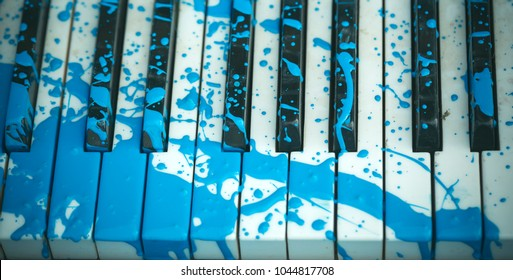 Painted piano, musical style, grunge instrument. Pop and classical music, melody, rhapsody. Art, decoration, design, old piano. Piano in blue paint stain, keyboard. Music academy, jazz, education.