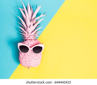 Painted pineapple with sunglasses on a vibrant duotone background