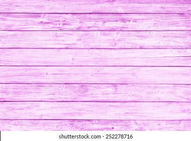 Painted Plain Red Pink Rustic Wood Board Background that can be horizontal or vertical. Blank Room or Space area for copy, text,  your words, above looking down view. Tinted photo.