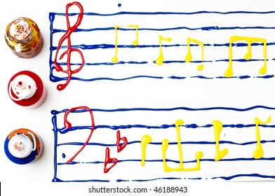 Painted sheet music with notes and symbols