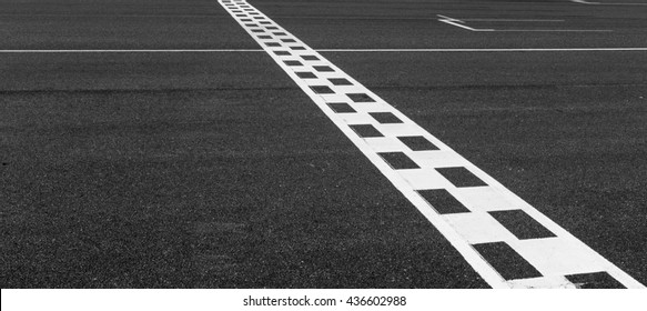 The painted start and finish line across the race track.