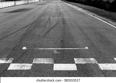 The painted start/finish line across the track