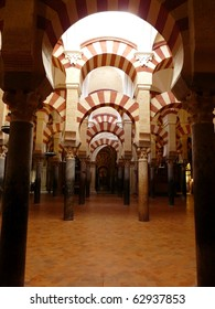 Painted and striped arches in the Mezquita, the old Mosque, in Cordoba, Spain