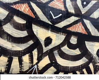 Painted tribal pattern on wood texture for interesting backgrounds.