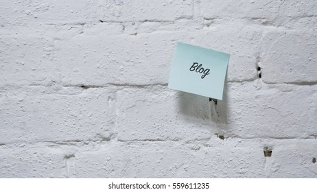 painted white brick wall, words on a paper sticker