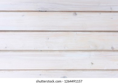 Painted white wooden plank or wall background with horizontal boards and copy space in a full frame view