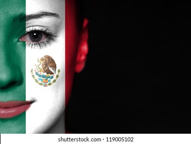 Painted woman face with flag of Mexico