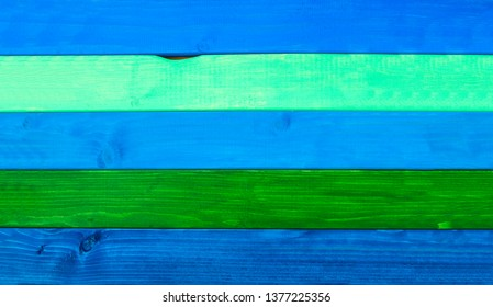 Painted wood, in blue and green planks, natural design, as a wooden background.