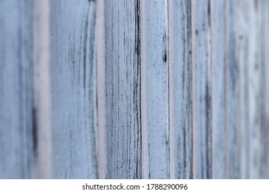 painted wooden planks fence made from side focus on center part