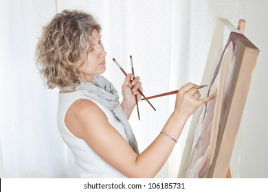 Painter Artist creates pictorial art.